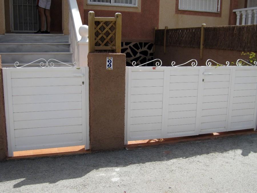 Modificar puertas de aluminio exterior santa pola for Puertas prefabricadas precios