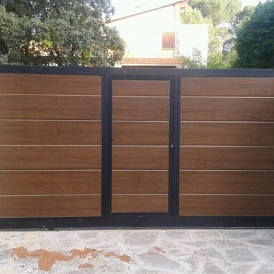 Instalar puerta garaje met lica godelleta valencia for Puerta garaje metalica