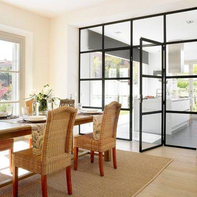 Pared de cuarterones de cristal con puertas correderas - Cocina salon separados cristal ...