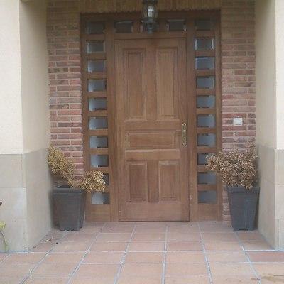 aislar puerta de entrada del fr o con cerramiento cristal