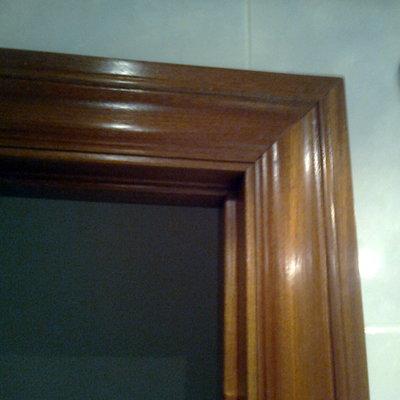 Sustitucion revestimiento marcos de madera de puertas l for Marco puerta madera