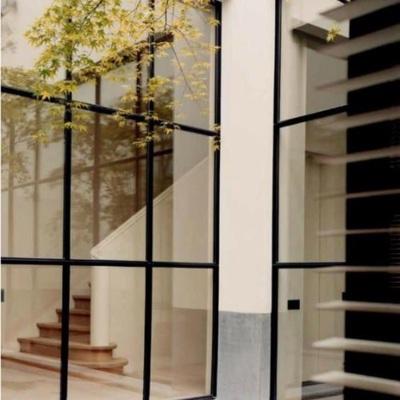 Ventanales grandes con marco negro de aluminio tarifa for Ventanales de aluminio zona sur
