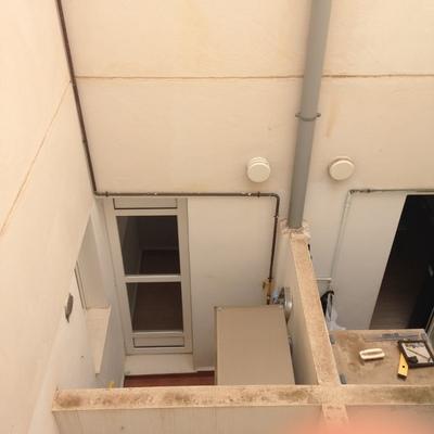 Instalar tubos campana en fachada interior de adosado ...