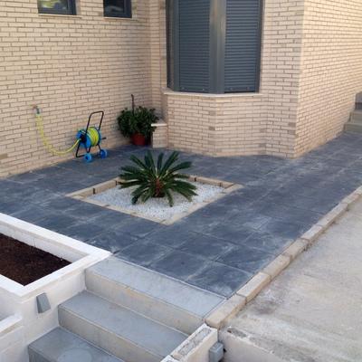 Aplicar barniz con tinte de de cemento impreso sobre for Terrazo exterior precios