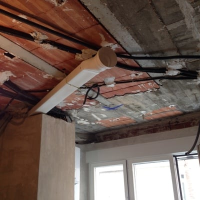 Instalar campana extractora de cocina empotrada en el for Campana extractora de techo