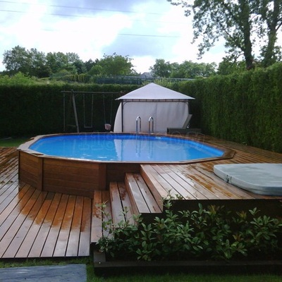 Construcci n piscina madera semienterrada caraquiz - Piscinas de madera semienterradas ...