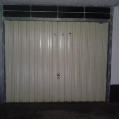 Reformar puerta garaje basculante de muelles colocandole for Reformar puertas