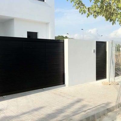 Puerta corredera hierro exterior el montmell tarragona for Puertas para patio exterior