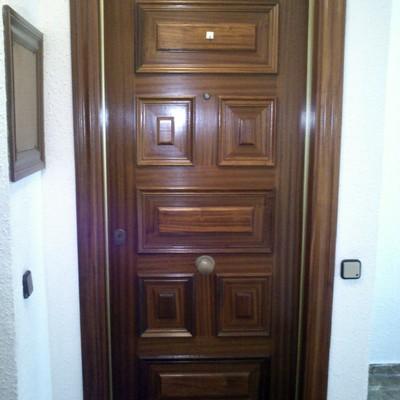 Reparar puerta blindada l 39 hospitalet de llobregat for Reparar puerta madera