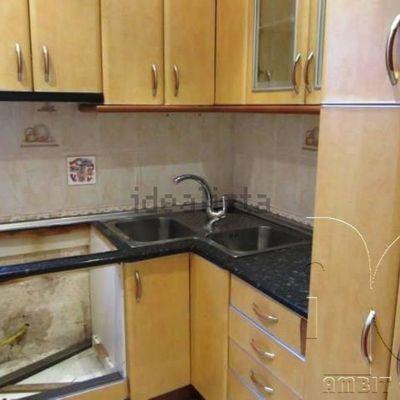 Reforma de cocina aprovechando modulos cambio bisagras y for Precio encimera marmol