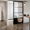 Fabricación e instalación de puerta corredera de hierro y vidrio