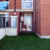 Cerramiento en pvc de terraza de salida al jardin de un bajo
