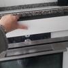 Instalación de campana de cocina y frontal de horno