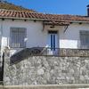 Revestimiento impermeable con mortero monocapa en fachada y muros de alrededor de la casa