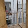 Cerramiento galeria con correderas de aluminio y puerta a 90º
