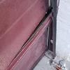 Pequeña reparación puerta garage tras golpe coche