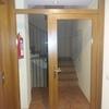Intalacion de carpinteria de madera acristalada para hueco de pasillo con puerta de iguales características