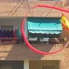Toldo portada brazo tensión manual con tejido acrílico de color verde para terraza de mi piso
