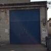 Suministro y colocación puerta basculante metálica en nave industrial