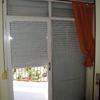 Cambiar puerta y ventana de madera a aluminio (y persianas)