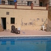 Reformar playa piscina y paredes colindantes