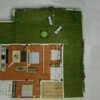 Hormigon impreso en jardin de piso bajo