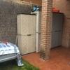 Muro separación parcela de vecinos