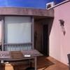 Instalación de toldo pergo rain en terraza más telón frontal