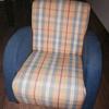 Un sillón tipo modeló milu