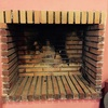 Instalación de una puerta para chimenea