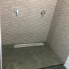 Panel separador para hueco de dos duchas