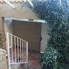 Reparación humedad y colocación de puerta exterior con remate en pared y condenar otra puerta