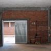 Sustituir puerta entrada a garaje por una elevable y mas grande 3x3,5 m aprox