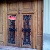 Reparación cerrajeria y puesta a punto de puerta madera, dos hojas y exterior