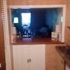 Quitar azulejos de la cocina , arrancar muebles viejos y alicatarlo , los materiales los pongo yo