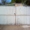 Ajustar portón y cambiar cerradura