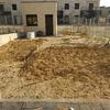 Muros de parcela y relleno de tierra para nivelarla