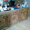Recogida y entrega de un mueble mostrador de madera