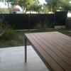 Instalar suelo (40 m2) y barbacoa en jardín.