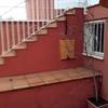 Hacer habitación bajo escalera de entrada del adosado