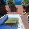 Reforma escalera exterior y cerrar una piscina por terraza encima