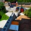 Terminar parking de obra (techo, frontal con puerta automatica y terminal laterales)