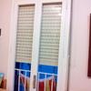 Cambiar ventanas (y una puerta) de madera por alumninio blanco