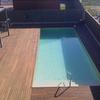 Construcción completa desde el inicio de piscina hormigón rectangular 1,40 aprox acho x 10 m largo aprox, debe ir pegada al muro en zona exterior del jardin, climatizada y con cerramiento automatico