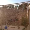 Instalación de mimbre en reja de terraza