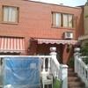 Cubrir terraza con un porche de madera y teja